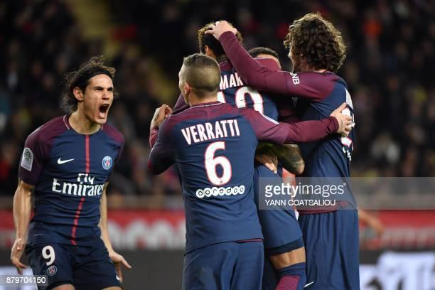 TOPSHOT Paris SaintGermain's Brazilian forward Neymar celebrates with teammates after scoring a penalty kick during the French L1 football match...