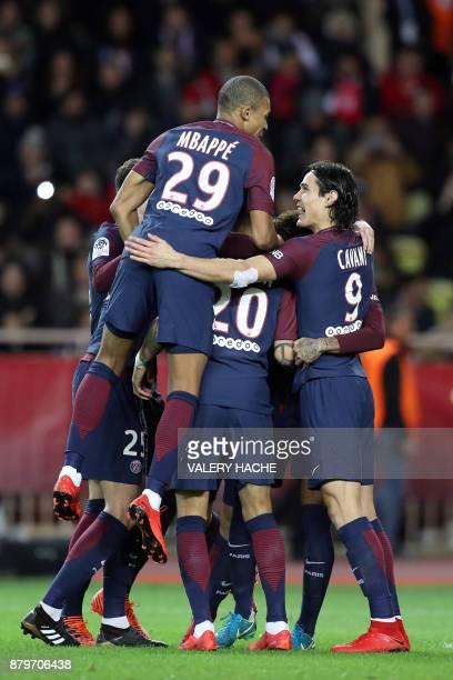 Paris SaintGermain's Brazilian forward Neymar celebrates with teammates after scoring a penalty kick during the French L1 football match between...