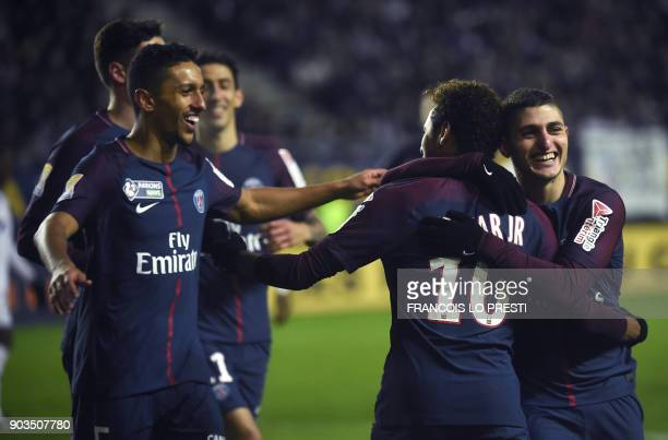 Paris SaintGermain's Brazilian forward Neymar celebrates with teammates after scoring a penalty kick during the French League Cup quarterfinal...