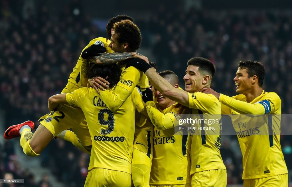 Paris Saint-Germain's Brazilian forward Neymar (C) celebrates with teammates after scoring a goal during French L1 football match between Lille Losc and Paris Saint-Germain (PSG), at the Pierre-Mauroy stadium, in Villeneuve-d'Ascq, on February 3, 2018. /
