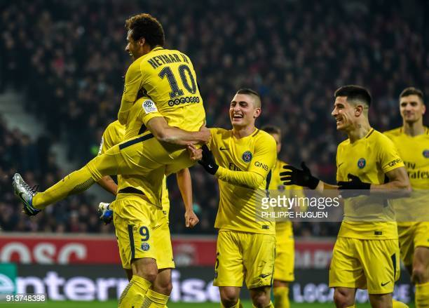 Paris SaintGermain's Brazilian forward Neymar celebrates with teammates after scoring a goal during French L1 football match between Lille Losc and...