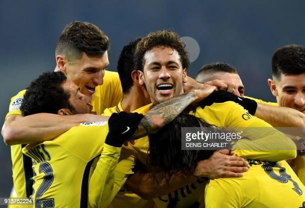 TOPSHOT Paris SaintGermain's Brazilian forward Neymar celebrates with teammates after scoring a goal during French L1 football match between Lille...