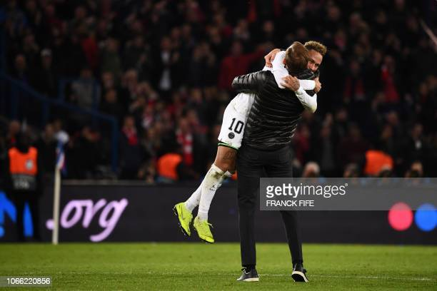 TOPSHOT Paris SaintGermain's Brazilian forward Neymar celebrates with Paris SaintGermain's German coach Thomas Tuchel after winning at the end of the...