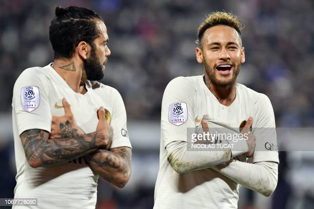 Paris SaintGermain's Brazilian forward Neymar celebrates with Paris SaintGermain's Brazilian defender Dani Alves after scoring the opening goal...