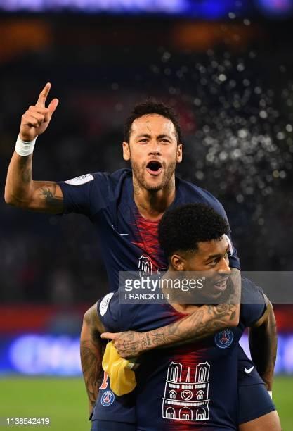 Paris Saint-Germain's Brazilian forward Neymar celebrates with Paris Saint-Germain's French defender Presnel Kimpembe after winning the French L1...