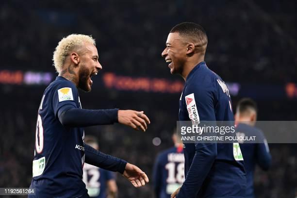 Paris SaintGermain's Brazilian forward Neymar celebrates with Paris SaintGermain's French forward Kylian Mbappe after scoring a goal during the...