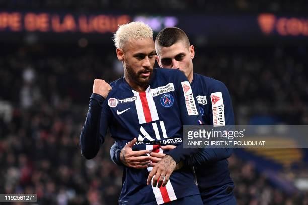 Paris SaintGermain's Brazilian forward Neymar celebrates with Paris SaintGermain's Italian midfielder Marco Verratti after scoring a goal during the...