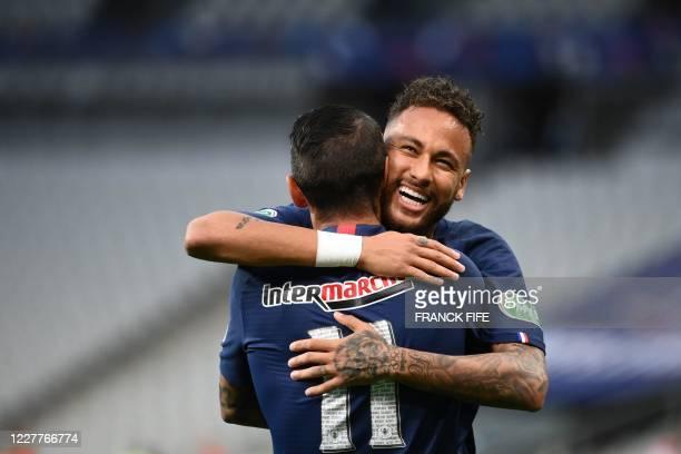 Paris SaintGermain's Brazilian forward Neymar celebrates with Paris SaintGermain's Argentine midfielder Angel Di Maria after scoring a goal during...