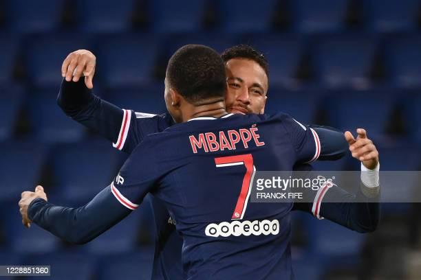 Paris Saint-Germain's Brazilian forward Neymar celebrates with Paris Saint-Germain's French forward Kylian Mbappe after scoring his team's second...