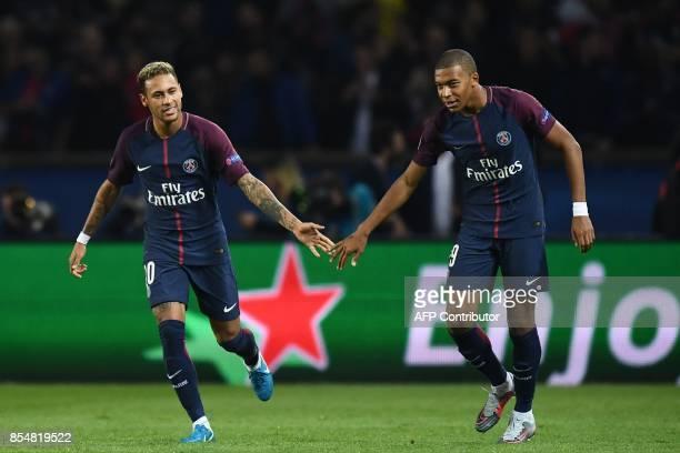 Paris SaintGermain's Brazilian forward Neymar celebrates with Paris SaintGermain's French forward Kylian Mbappe after scoring a goal during the UEFA...