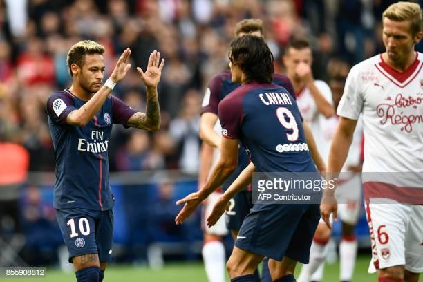 Paris SaintGermain's Brazilian forward Neymar celebrates with Paris SaintGermain's Uruguayan forward Edinson Cavani after scoring a penalty kick as...