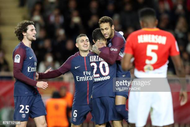 TOPSHOT Paris SaintGermain's Brazilian forward Neymar celebrates with Paris SaintGermain's French defender Layvin Kurzawa Paris SaintGermain's...