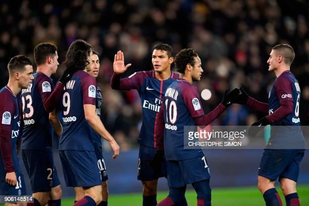 Paris SaintGermain's Brazilian forward Neymar celebrates with Paris SaintGermain's Italian midfielder Marco Verratti after PSG scored its second goal...