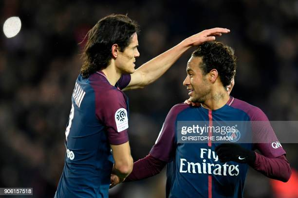 Paris SaintGermain's Brazilian forward Neymar celebrates with Paris SaintGermain's Uruguayan forward Edinson Cavani after scoring a freekick during...