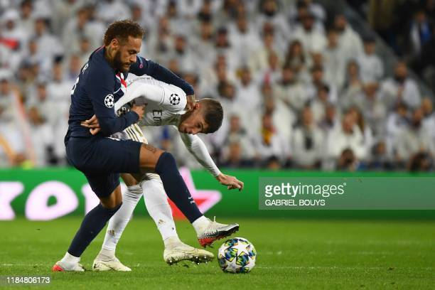 Paris SaintGermain's Brazilian forward Neymar challenges Real Madrid's Uruguayan midfielder Federico Valverde during the UEFA Champions League group...