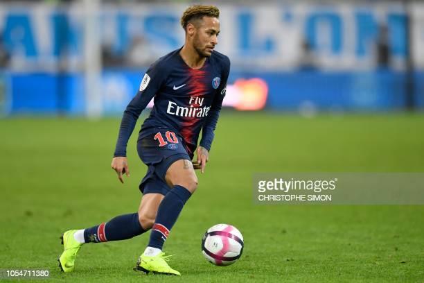 Paris SaintGermain's Brazilian forward Neymar controls the ball during the French L1 football match between Olympique de Marseille and Paris...