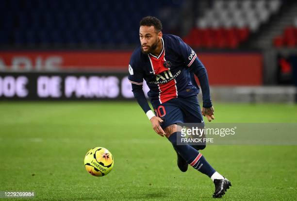 Paris Saint-Germain's Brazilian forward Neymar controls the ball during the French L1 football match between Paris Saint-Germain and Dijon at the...