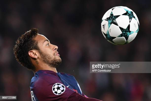 Paris SaintGermain's Brazilian forward Neymar controls the ball during the UEFA Champions League Group B football match between Paris SaintGermain...
