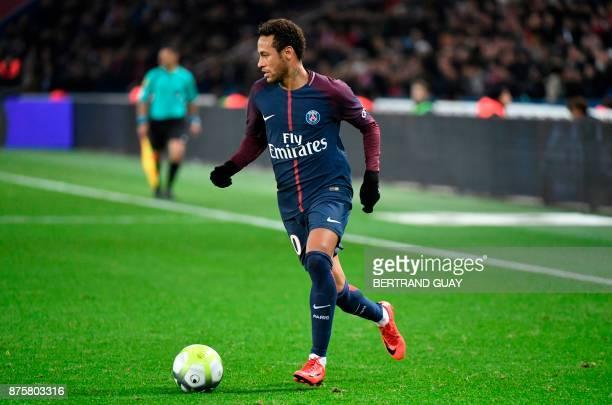 Paris SaintGermain's Brazilian forward Neymar controls the ball during the French L1 football match between Paris SaintGermain and Nantes at the Parc...