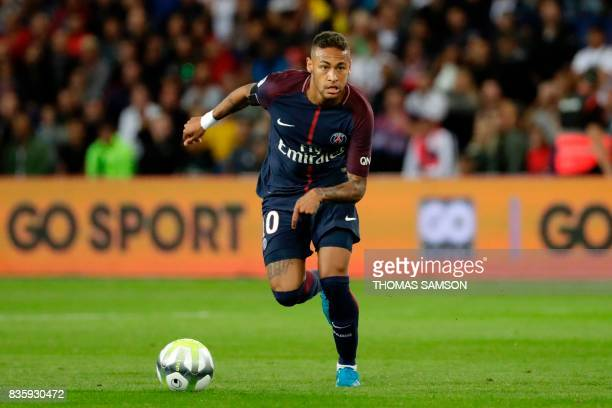 Paris SaintGermain's Brazilian forward Neymar drives the ball during the French L1 football match Paris SaintGermain vs Toulouse FC at the Parc des...