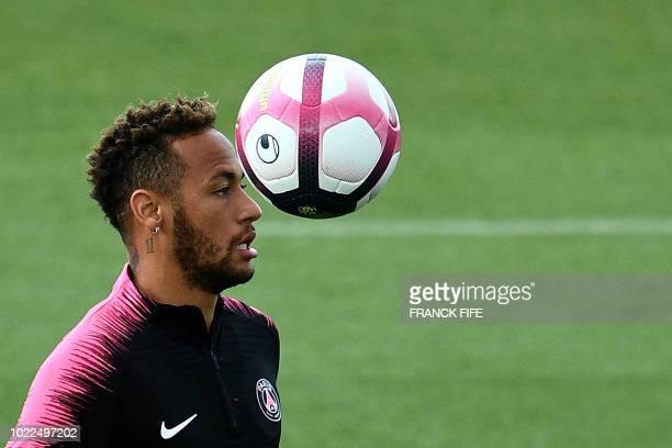 Paris SaintGermain's Brazilian forward Neymar eyes the ball during a training session of the Paris SaintGermain football team on August 24 2018 at...