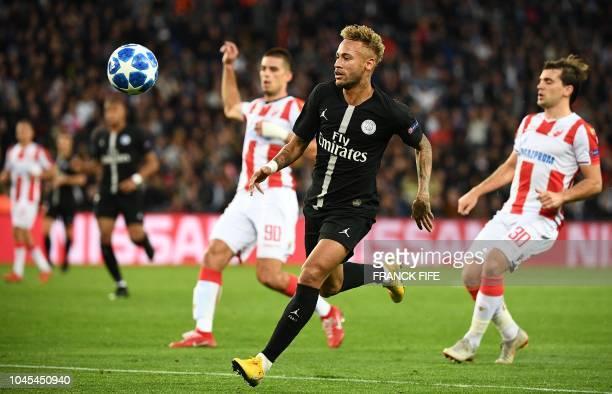 Paris SaintGermain's Brazilian forward Neymar eyes the ball during the UEFA Champions' League football match Paris Saint Germain against Red Star...