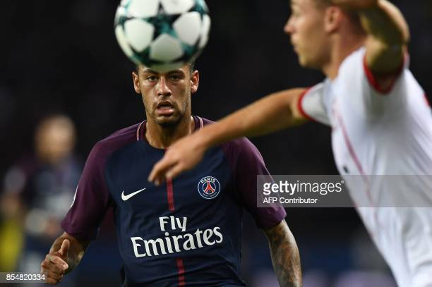 Paris SaintGermain's Brazilian forward Neymar eyes the ball during the UEFA Champions League football match between Paris SaintGermain and Bayern...
