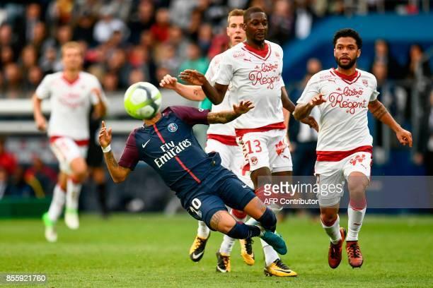 Paris SaintGermain's Brazilian forward Neymar falls after being tackled by Bordeaux's Senegalese midfielder Younousse Sankhare as Bordeaux's...