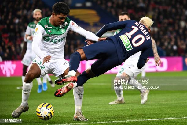 Paris SaintGermain's Brazilian forward Neymar falls as he vies for the ball with SaintEtienne's French defender Wesley Fofana during the French...