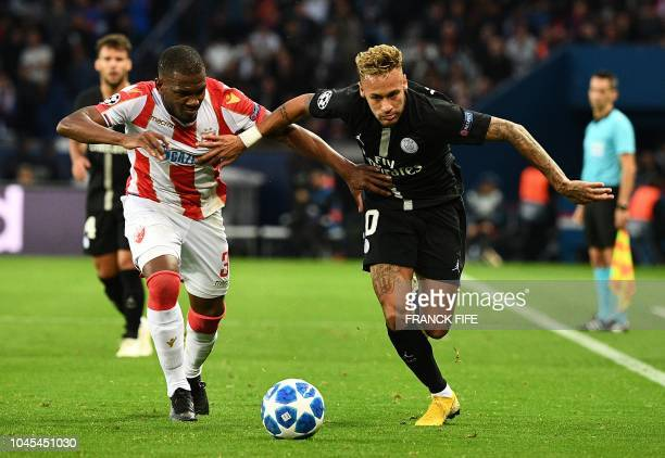 TOPSHOT Paris SaintGermain's Brazilian forward Neymar fights for the ball with Red Star Belgrade's defender Branko Jovicic during the UEFA Champions'...