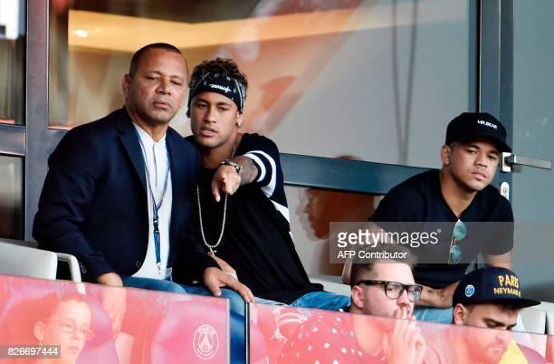 Paris SaintGermain's Brazilian forward Neymar flanked by a close friend Jo Amancio speaks with his father Neymar Santos as they attend the French L1...