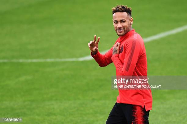 Paris SaintGermain's Brazilian forward Neymar gestures during a training session at the team's Camp des Loges training grounds in SaintGermainenLaye...