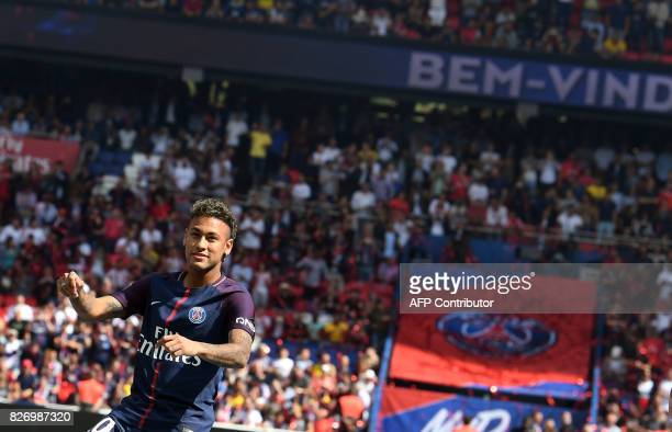 Paris SaintGermain's Brazilian forward Neymar gestures during his presentation to the fans at the Parc des Princes stadium in Paris on August 5 2017...