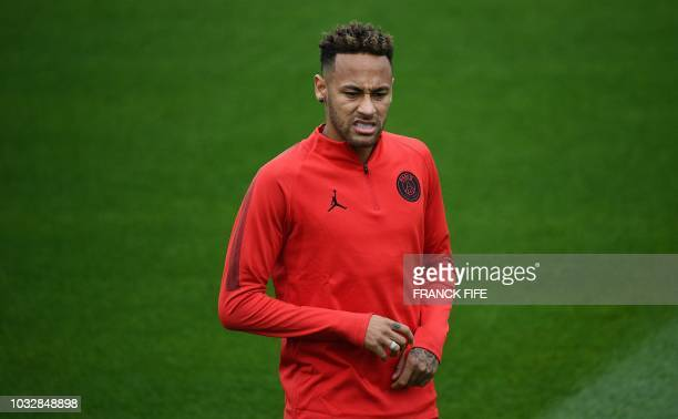 Paris SaintGermain's Brazilian forward Neymar grimaces during a training session at SaintGermainenLaye western Paris on September 13 2018 on the eve...