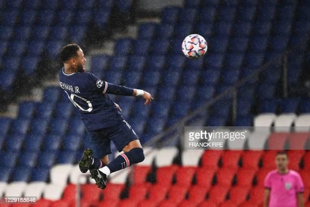 Paris SaintGermain's Brazilian forward Neymar heads the ball during the UEFA Champions League Group H firstleg football match between Paris...