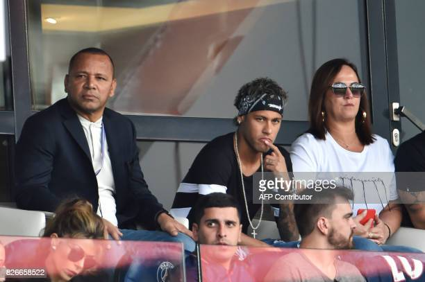 Paris SaintGermain's Brazilian forward Neymar his father Neymar Santos and mother Nadine Santos attend the French L1 football match between Paris...