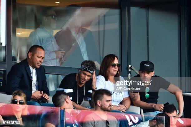 Paris SaintGermain's Brazilian forward Neymar his father Neymar Santos mother Nadine Santos close friend Jo Amancio and agent Wagner Ribeiro attend...