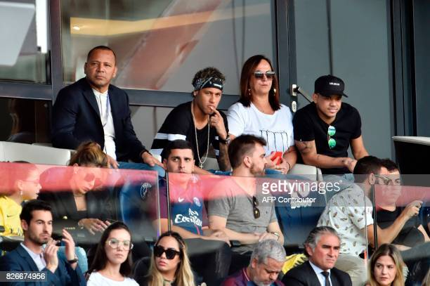Paris SaintGermain's Brazilian forward Neymar his father Neymar Santos mother Nadine Santos and a close friend Jo Amancio react as they attend the...
