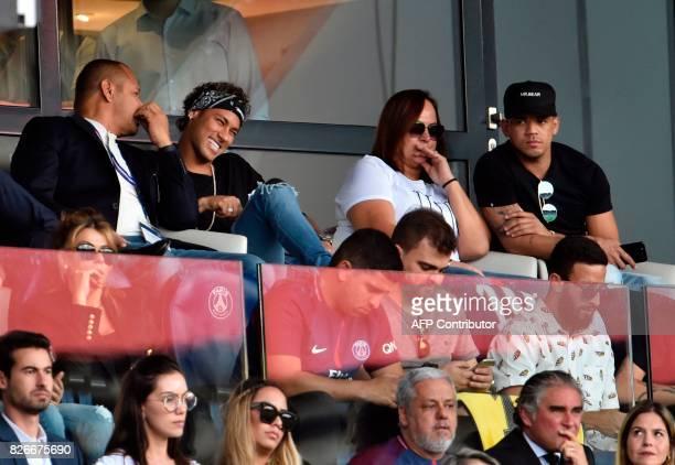 Paris SaintGermain's Brazilian forward Neymar his father Neymar Santos mother Nadine Santos and a close friend Jo Amancio react as they attend the...