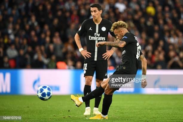 Paris SaintGermain's Brazilian forward Neymar hits a free kick and scores during the UEFA Champions' League football match Paris Saint Germain...
