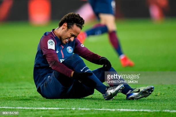 Paris SaintGermain's Brazilian forward Neymar hold his ankle during the French L1 football match between Paris SaintGerman and Dijon on January 17...