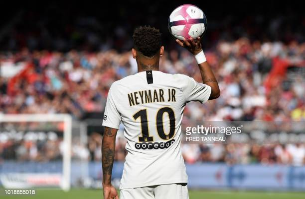 Paris Saint-Germain's Brazilian forward Neymar holds a ball in the palm of his hand during the French L1 football match between Guingamp and Paris...