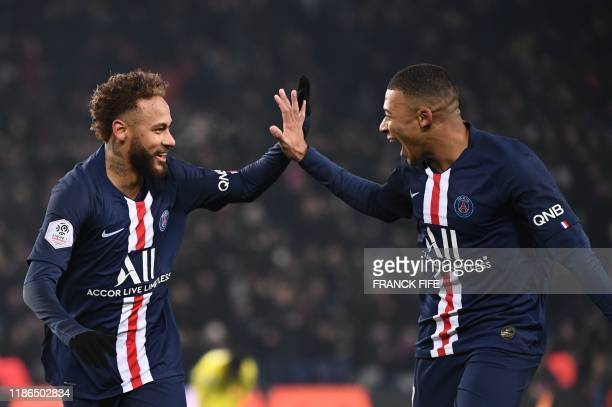 TOPSHOT Paris SaintGermain's Brazilian forward Neymar is congratulated by Paris SaintGermain's French forward Kylian Mbappe after scoring his team's...