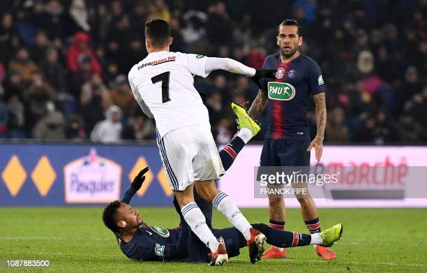 Paris SaintGermain's Brazilian forward Neymar is tackled by Strasbourg's Tunisian midfielder Moataz Zemzemi during the French Cup round of 32...