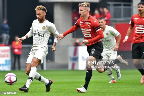 Paris SaintGermain's Brazilian forward Neymar ischased by Rennes' French midfielder Benjamin Bourigeaud during the French L1 football match between...