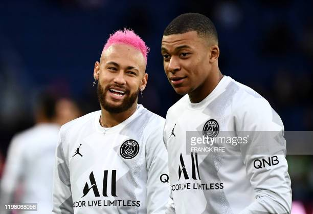 Paris SaintGermain's Brazilian forward Neymar jokes with Paris SaintGermain's French forward Kylian MBappe prior to the French L1 football match...