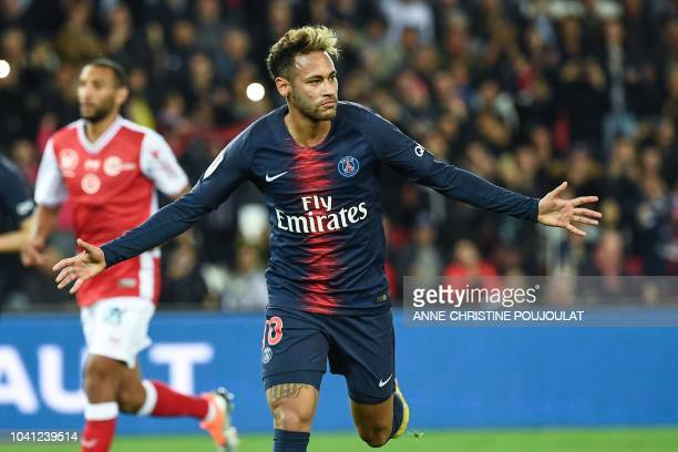Paris SaintGermain's Brazilian forward Neymar Jr celebrates after scoring a goal during the French L1 football match between Paris Saint Germain and...