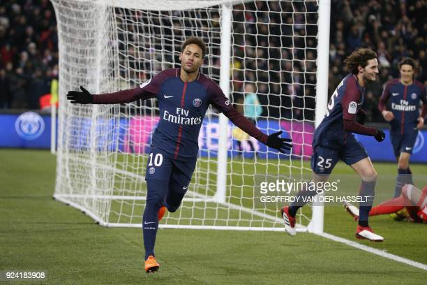 Paris SaintGermain's Brazilian forward Neymar Jr celebrates after Marseille's Portuguese defender Rolando scored an own goal after a kick of Neymar...