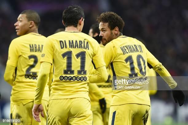 Paris SaintGermain's Brazilian forward Neymar Jr celebrates opening the scoring with Paris SaintGermain's Argentinian forward Angel Di Maria and...