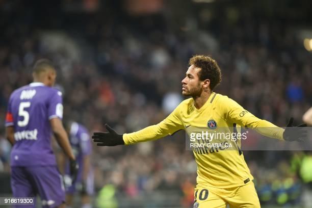 Paris SaintGermain's Brazilian forward Neymar Jr celebrates opening the scoring during the French L1 football match between Toulouse and Paris...